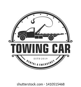 Silhouette towing car logo design