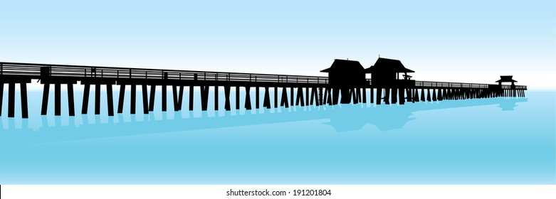 Silhouette of a tropical pier on the Gulf of Mexico in Naples, Florida, USA.