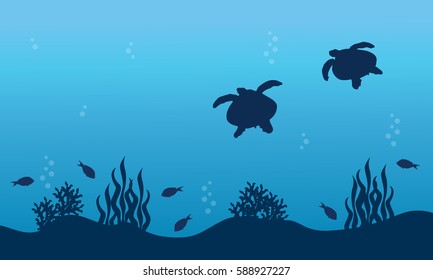 Silhouette of turtle fish and reef landscape