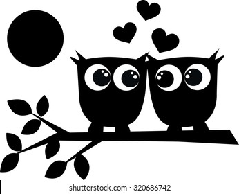 silhouette of two black owls in love