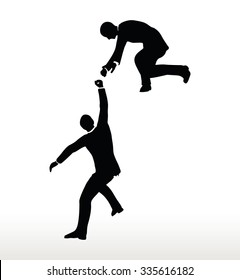 silhouette of two businessmen team holding on with a helping hand