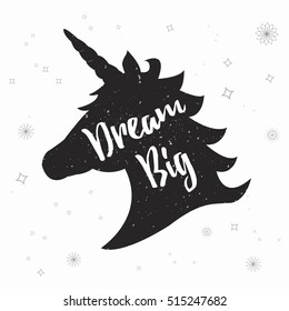Silhouette of a unicorn with inspirational quote isolated on white background. Dream Big