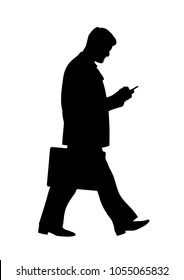 Silhouette of walking businessman. Full length side view of a young business man with a suitcase, looking at smartphone. Office worker  moving forward and holding a mobile phone. Vector illustration.