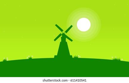 Silhouette of windmill with green background vector art