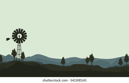silhouette windmills on the hill
