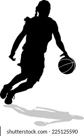 Silhouette of woman basketball player on a fast break with shadow.
