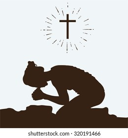 Silhouette of a woman kneeling in prayer