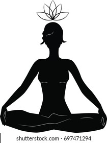 silhouette of woman practicing yoga in lotus position