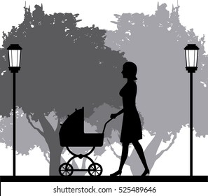 silhouette woman walking with pram baby in park