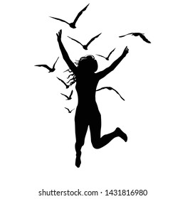 Silhouette of a woman who jump and birds flying