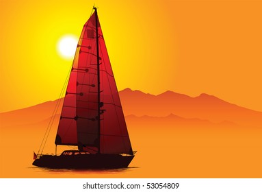Silhouette of yacht under sail at sunset