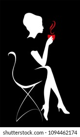 Silhouette of a Young female holding hot coffee or tea