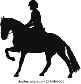 Silhouette of a young horsewoman galloping on a pony