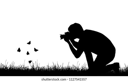 Silhouette of a young man photographing flying butterflies in a lawn - vector