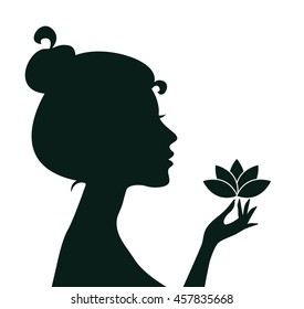 Silhouette of a young woman holding a Lotus flower. Vector illustration