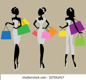 Silhouettes of 3 women with colorful shopping bags , vintage fashion of 1950s, 1960s