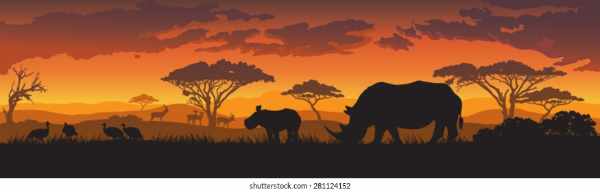 Silhouettes of african wild animals at sunset or sunrise