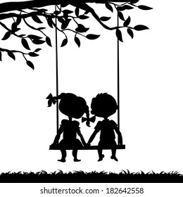 Silhouettes of a boy and a girl sitting on a swing