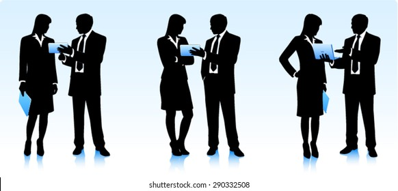 Silhouettes of businessmen with computers
