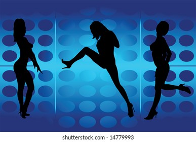 Silhouettes of dancing girls in a party