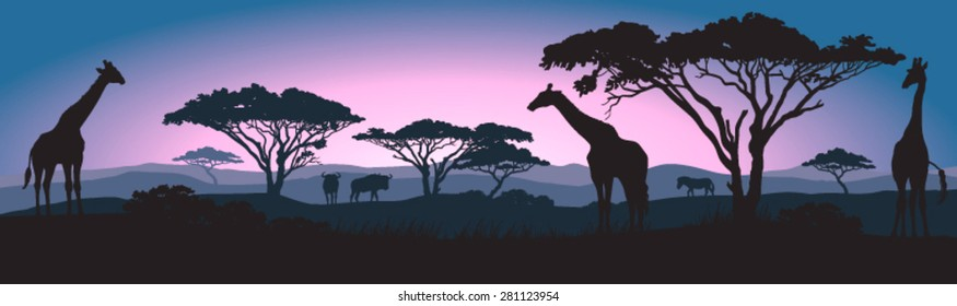 Silhouettes of giraffes and other wild African animals at sunrise