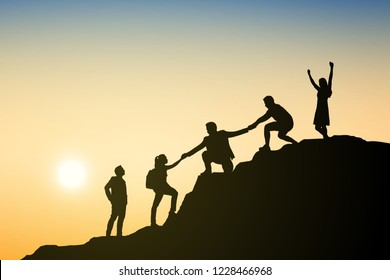 Silhouettes group businessman climbing on mountain and helping at sunset. Help and assistance concept. Eps10 Vector illustration.