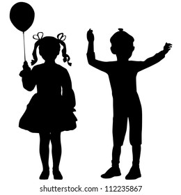 Silhouettes of happy kids - girl and boy