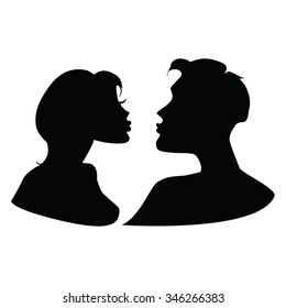 Silhouettes of kissing couple.