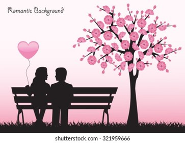 Silhouettes loving couple sitting on a bench next to a cherry tree with flowers.