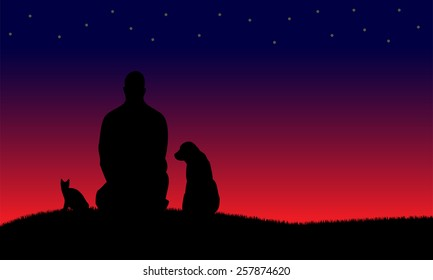Silhouettes of man and dog and cat