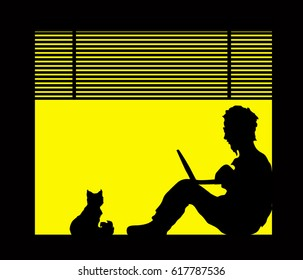 Silhouettes of man with a laptop and a cat are sitting on the window sill.