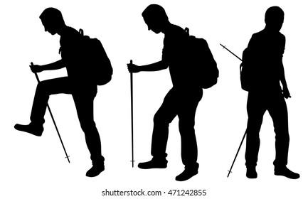 silhouettes of men trekking