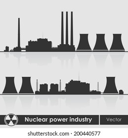 Silhouettes of a nuclear power plants. Vector illustration.