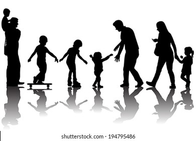 Silhouettes of parents with kids in the park