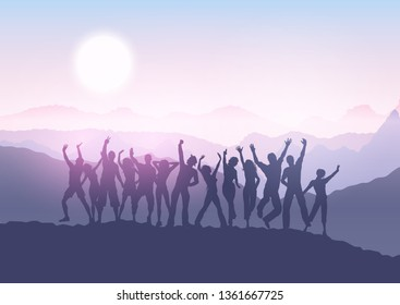 Silhouettes of people dancing in a sunset mountain landscape