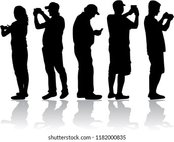 Silhouettes of people making photos.
