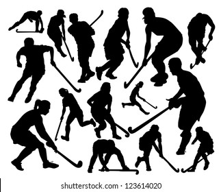 silhouettes of the players in hockey on the grass