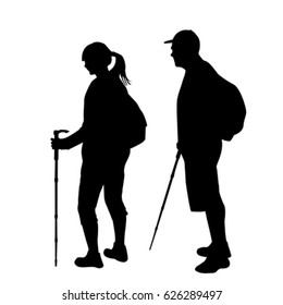 Silhouettes of two hikers with backpacks on white background