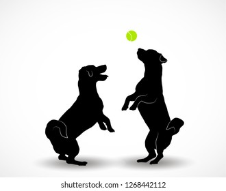 Silhouettes of two small cute dogs Jack Russell Terrier standing on hind legs, jumpimg playing with ball. Vector illustration isolated on white background.
