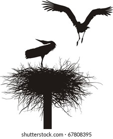 Silhouettes of two storks to nest