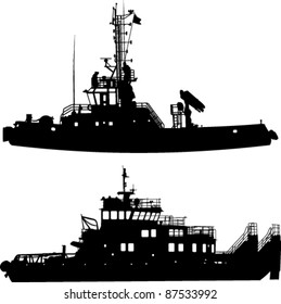 Silhouettes of two towboat
