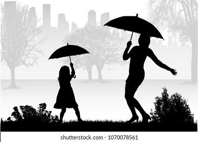 Silhouettes under the umbrella.