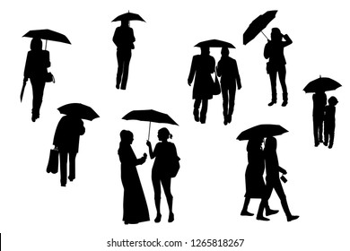 Silhouettes of walking people under the umbrellas, vector, set.
