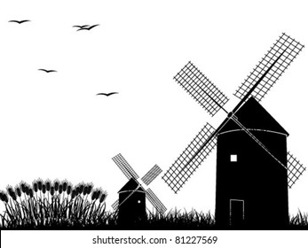 Silhouettes of windmills isolated on white