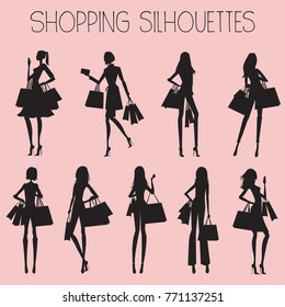 Silhouettes of Women Shopping, with pink background- vector eps10