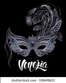 Silver carnival mask with feathers on black background. Venetian carnival. Concept design with hand drawn lettering for t-shirt print,  poster, greeting card, party invitation, banner or flyer.