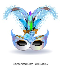 The silver carnival mask with multicolor feathers. The mask decorated with blue pattern and blue roses.