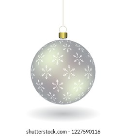 Silver Christmass ball with snowflakes print hanging on a golden chain