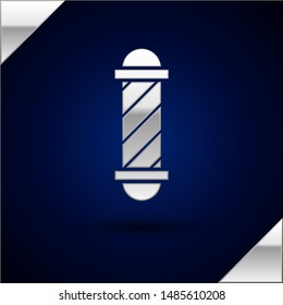 Silver Classic Barber shop pole icon isolated on dark blue background. Barbershop pole symbol.  Vector Illustration