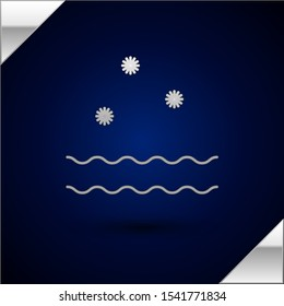 Silver Cold and waves icon isolated on dark blue background. Vector Illustration